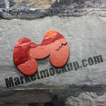 موکاپ لوگو برجسته بر روی دیوار سنگی